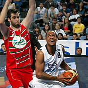 Efes Pilsen's Lawrence ROBERTS (R) and Pinar Karsiyaka's Emre BAYAV (L) during their Turkish Basketball Legague Play-Off qualifying first match Efes Pilsen between Pinar Karsiyaka at the Sinan Erdem Arena in Istanbul Turkey on Wednesday 11 May 2011. Photo by TURKPIX
