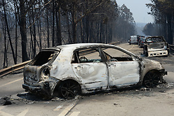 June 18, 2017 - Pedrogao Grande, Portugal - The wreckage of cars after a devastating forest fire in the area of Pedrogao Grande, killed 62 people, with 54 others injured. The fire enveloped a stretch of road in central Portugal, killing at least 30 motorists who were trapped in their cars.. (Credit Image: © Zhang Liyun/Xinhua via ZUMA Wire)