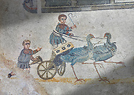 Roma children's chariot race from The Vestibule of The Smnall Circus, room no 41 - Roman mosaics at the Villa Romana del Casale,  circa the first quarter of the 4th century AD. Sicily, Italy. A UNESCO World Heritage Site. .<br /> <br /> If you prefer to buy from our ALAMY PHOTO LIBRARY  Collection visit : https://www.alamy.com/portfolio/paul-williams-funkystock/villaromanadelcasale.html<br /> Visit our ROMAN MOSAICS  PHOTO COLLECTIONS for more photos to buy as buy as wall art prints https://funkystock.photoshelter.com/gallery/Roman-Mosaics-Roman-Mosaic-Pictures-Photos-and-Images-Fotos/G00008dLtP71H_yc/C0000q_tZnliJD08