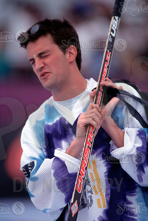 Aug 22, 1996; Santa Monica, California, USA; Actor Matthew Perry with his hockey gear at the beach after a taping of the Hollywood Hockey Cup at the '96 NHL Breakout in the parking lot south of the Santa Monica Pier in California.  Perry grew up in Canada playing ice hockey and picked up roller hockey when he  moved to Los Angeles.  Mandatory Credit: Photo by Shelly Castellano/ZUMA Press. (©) Copyright 1996 by Shelly Castellano