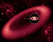 This artist's conception shows a nearly invisible ring around Saturn -- the largest of the giant planet's many rings. It was discovered by NASA's Spitzer Space Telescope. The ring is so diffuse that it reflects little sunlight, or visible light that we see with our eyes. But its dusty particles shine with infrared light, or heat radiation, that Spitzer can see. The artist's conception simulates an infrared view of the giant ring. Saturn appears as just a small dot from outside the band of ice and dust. The bulk of the ring material starts about six million kilometres (3.7 million miles) away from the planet representation.