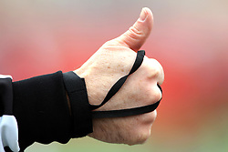 06 December 2014:  Normal Illinois.  A football official holds his thumb up to indicate he is ready for play to resume during a 1st round FCS NCAA football game between the Panthers of Northern Iowa and the Redbirds of Illinois State in Hancock Stadium.  Illinois State won the game 41-21.