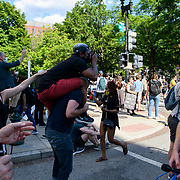 A protester tries to get a better vantage point for a photo. Protests continue on Sunday at Washington DC's Lafayette Park, in response to the murder of George Floyd in Minneapolis. Various police agencies kept the protesters in the park, preventing them from getting close to the White House.