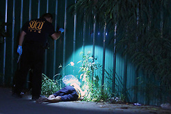 November 15, 2016 - Philippines - (EDITOR'S NOTE: Image depicts death) Members of S.O.C.O. (Scene of the Crime Operatives) and Philippine National Police (PNP) investigator process the crime scene and the remain of two un-identified summary execution victims at Diokno Blvd. Brgy 76, Zone 10, Pasay. It'Äôs a part of the total out war campaign by the government about illegal drugs. (Credit Image: © Gregorio B. Dantes Jr/Pacific Press via ZUMA Wire)