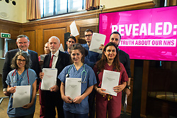 "© Licensed to London News Pictures. 27/11/2019. London, UK. British Labour party leader Jeremy Corbyn and NHS workers hold revealing official government documents showing the US is demanding that the NHS will be ""on the table"" in talks on a post-Brexit trade deal on the National Health Service. Photo credit: Ray Tang/LNP"