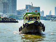 02 NOVEMBER 2018 - BANGKOK, THAILAND:  A tug boat pulls a barge up the Chao Phraya River in Bangkok.     PHOTO BY JACK KURTZ