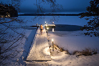 Walking back to the sauna after a late afternoon winter swim.