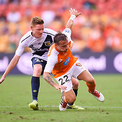 BRISBANE, AUSTRALIA - MARCH 31: Eric Bautheac of the Roar is fouled by Kye Rowles of the Mariners during the Round 25 Hyundai A-League match between Brisbane Roar and Central Coast Mariners on March 31, 2018 in Brisbane, Australia. (Photo by Patrick Kearney / Brisbane Roar FC)