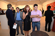 Poju Zabludowicz; Anita Zabludowicz; Ron Zabludowicz; , Korean Eye Dinner  hosted by The Dowager Viscountess Rothermere and Simon De Pury.Sponsored by CJ, Korean Food Globalization Team, Hino Consulting and Visit Korea Committee. Phillips de Pury Space, Saatchi Gallery.  Sloane Sq. London. 2 July 2009.