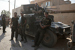Licensed to London News Pictures. 23/10/2016. Iraqi Army  Counter Terrorism soldiers relax in the Iraqi Town of Bartella.<br /> <br /> Bartella, a mainly Christian town with a population of around 30,000 people before being taken by the Islamic State in August 2014, was captured two days ago by the Iraqi Army's Counter Terrorism force as part of the ongoing offensive to retake Mosul. Although ISIS militants were pushed back a large amount of improvised explosive devices are still being found in the town's buildings. Photo credit: Matt Cetti-Roberts/LNP