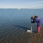 Inuit woman prepares for the day's fishing. Barrow, Alaska