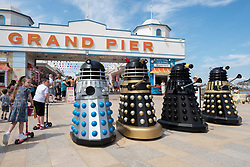 © Licensed to London News Pictures; 30/05/2021; Weston-super-Marel, UK. Four Daleks, organised by Ian and Tracy McTeague, patrol the promenade interacting with the public on the late May bank holiday weekend during the covid coronavirus pandemic as restrictions have been eased to allow travel and staycations in England and Wales. The weather is forecast for this weekend to have the hottest day of the year so far. Photo credit: Simon Chapman/LNP.
