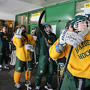 Hamden High School Hockey players react as Canada score their equalizing goal in the last minute of the Women's Hockey Final at the Winter Olympic games in Sochi Russia. The boys had stopped scrummaging before training to watch the last minutes of the game. Hamden. Connecticut, USA. 20th February 2014. Photo Tim Clayton