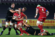 Aaron Shingler of the Scarlets is tackled by James King, Alun Wyn Jones (l) and Bradley Davies of the Ospreys. . Guinness Pro14 rugby match, Ospreys v Scarlets at the Liberty Stadium in Swansea, South Wales on Saturday 7th October 2017.<br /> pic by Andrew Orchard, Andrew Orchard sports photography.
