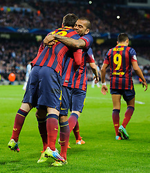 Barcelona Midfielder Lionel Messi (ARG) celebrates with Defender Daniel Alves (BRA) after scoring a goal from a penalty - Photo mandatory by-line: Rogan Thomson/JMP - Tel: 07966 386802 - 18/02/2014 - SPORT - FOOTBALL - Etihad Stadium, Manchester - Manchester City v Barcelona - UEFA Champions League, Round of 16, First leg.