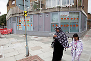 Muslim mother and daughter on Cable Street in Tower Hamlets, East London. Many people are at risk of losing their homes in London with the introduction of new benefit rules, which may push many people renting or who own council apartments out of the city.