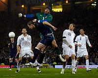 Photo: Jed Wee/Sportsbeat Images.<br /> Scotland v Italy. UEFA European Championships Qualifying. 17/11/2007.<br /> <br /> Italy goalkeeper Gianluigi Buffon (R) beats Scotland's David Weir to the ball.