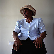 Nurse Cooper who checks up on the old and vunerable in the new northern community of Lookout. Thousands were evacuated from their homes in the south of the island after it was abandoned after the 1995 and 1997 eruption of the Soufriere Hills volcano. The southern area which contained most of the farm land is still out of bounds to everyone except scientists..Photo©Steve Forrest/Workers Photos
