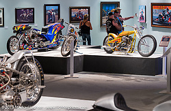 "Tator Gillmore's Top Fuel drag bike beside Bill Dodge's Panhead and Dan Rognsvoogs digger in the ""Built for Speed"" exhibition curated by Michael Lichter and Paul D'Orleans in the Russ Brown Events Center as part of the annual ""Motorcycles as Art"" series at the Sturgis Buffalo Chip during the Black Hills Motorcycle Rally. SD, USA. August 7, 2014.  Photography ©2014 Michael Lichter."