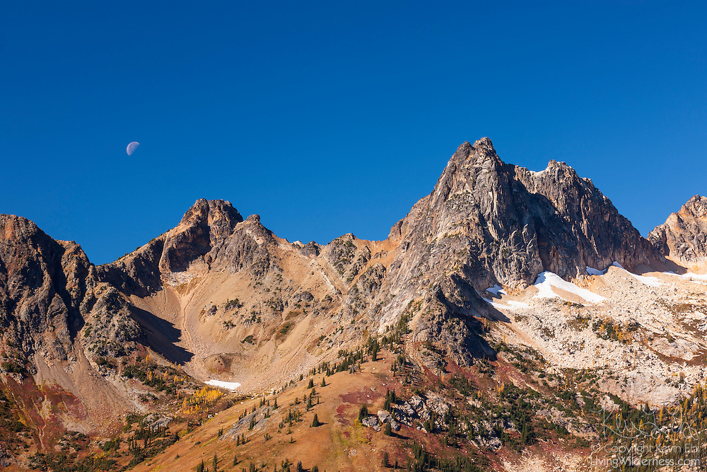 The half moon prepares to set behind Cutthroat Pass located in the North Cascades of Washington state. The pass is named for Cutthroat Peak, the 8050 foot (2454 meter) peak visible in the right half of this image.
