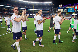 NEW YORK, NEW YORK, USA - Wednesday, July 24, 2019: Liverpool's captain Jordan Henderson and Dejan Lovren applaud the supporters after a friendly match between Liverpool FC and Sporting Clube de Portugal at the Yankee Stadium on day nine of the club's pre-season tour of America. The game ended in a 2-2 draw. (Pic by David Rawcliffe/Propaganda)