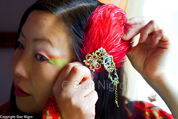 """Crimson butterfly hairpiece/accessory<br /> one of a kind<br /> <br /> This can be worn as a hairpiece/ accessory that can also be clipped  to a blouse,pocket book,hat etc. <br /> <br /> Materials: butterfly photo,red colored  feathers,shells and swarovski crystal with barrette clip for hair or accessory on clothing etc.<br /> <br /> size: 4 """" x 3 1/2"""" x 1/2""""<br /> <br /> price: $64.00<br /> <br /> <br /> + Giveback<br /> When you make a purchase from this site 7%  will be shared with a non-profit that focuses on making a positive difference in the world today.<br /> <br /> photo by Star Nigro<br /> <br /> StarNigro.com<br /> <br /> ©2021 All artwork is the property of STAR NIGRO.  Reproduction is strictly prohibited.<br /> <br /> Buying art  + Making a difference = Art with Heart<br /> <br /> <br /> <br /> <br /> ©2019 All artwork is the property of STAR NIGRO.  Reproduction is strictly prohibited."""