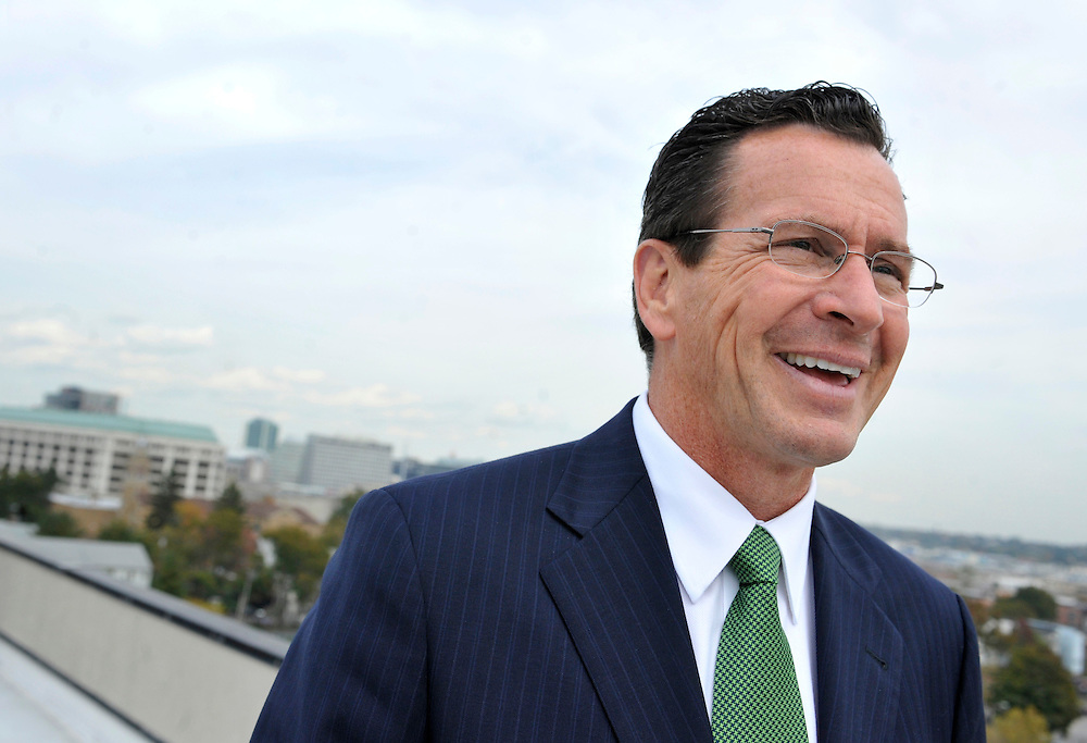 In this Oct. 20, 2010 photo, Democratic candidate for governor and former Stamford Mayor Dan Malloy stands atop an office building in an area of redevelopment in the south end of the city of Stamford, Conn. (AP Photo/Jessica Hill)