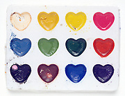 paint box with paint in heart form