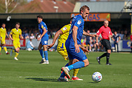 AFC Wimbledon striker James Hanson (18) dribbling during the EFL Sky Bet League 1 match between AFC Wimbledon and Bristol Rovers at the Cherry Red Records Stadium, Kingston, England on 19 April 2019.