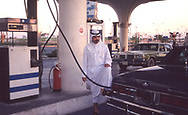 Saudi man pumping gas at a gas station in Daharahan in 1990<br /><br />Photograph ny Dennis Brack. bb78