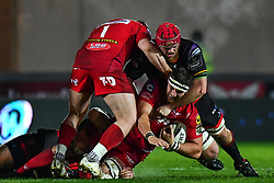 Scarlets' Steven Cummins is tackled by Dragons' Joseph Davies<br /> <br /> Photographer Craig Thomas/Replay Images<br /> <br /> Guinness PRO14 Round 13 - Scarlets v Dragons - Friday 5th January 2018 - Parc Y Scarlets - Llanelli<br /> <br /> World Copyright © Replay Images . All rights reserved. info@replayimages.co.uk - http://replayimages.co.uk