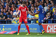 Scunthorpe United defender Cameron Burgess (21) refusing to give AFC Wimbledon midfielder Liam Trotter (14) the ball during the EFL Sky Bet League 1 match between AFC Wimbledon and Scunthorpe United at the Cherry Red Records Stadium, Kingston, England on 15 September 2018.
