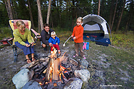 Sabin family roasts marshmallows around the campfire while camping near Whitefish Montana model released