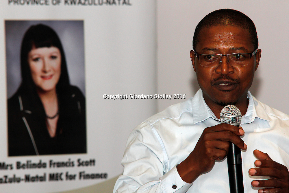 DURBAN - 19 April 2016 - Simiso Magagula, the Head of Department of the KwaZulu-Natal provincial treasury speaks at the launch of a training programme to have accountants do their article in the KwaZulu-Natal provincial treasury. In the background is a poster of KwaZulu-Natal's finance MEC Belinda Scott. Picture: Allied Picture Press/APP