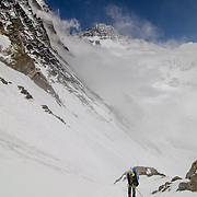 David Morton rappels down the West Ridge Headwall on Mount Everest toward Camp 2 in the Western Cwm. Lhotse rises from the clouds behind.