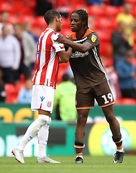 Stoke City's Tom Ince (left) and Brentford's Romaine Sawyers (right) after the match