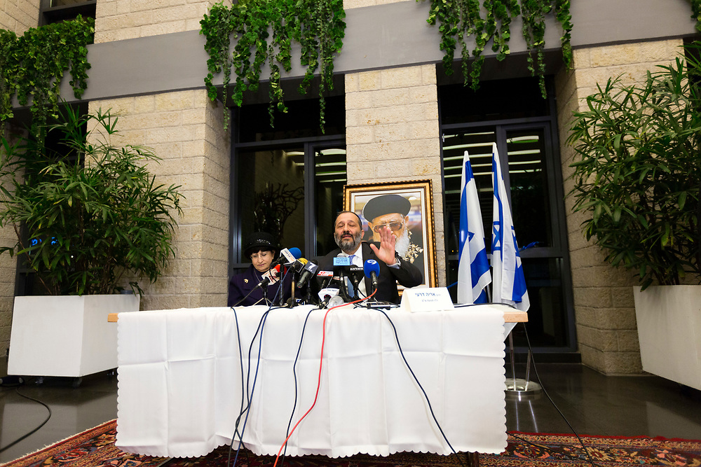 """Shas Party leader Aryeh Deri gestures as he speaks during a press conference with Adina Bar-Shalom, the daughter of the late Shas Party spiritual leader Rabbi Ovadia Yoesf, at the party's headquarters in Jerusalem, on December 14, 2014. Deri and Bar-Shalom announced that she would head a special """"Women's Advisory Committee"""" that would work with Shas to develop policies to help women and families."""
