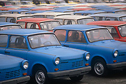Six months after the fall of the Berlin Wall, the last Trabant cars await buyers outside the factory production line, on 1st June 1990, in Zwickau, eastern Germany former DDR. The DDR-produced Trabant suffered poor performance, but its smoky two-stroke engine regarded with affection as a symbol of the more positive sides of East Germany. Many East Germans streamed into West Berlin and West Germany in their Trabants after the opening of the Berlin Wall. It was in production without any significant change for nearly 30 years. The name Trabant means fellow traveler in German.