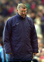 Photo: Greig Cowie<br />Barclaycard Premiership. Manchester United v Manchester City. 09/02/2002<br />A dejected Alex Ferguson leaves the field after his side conceded a late equaliser