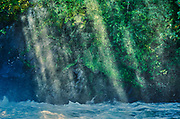 Sun streaking through mist on The Grass River at Pisew Falls<br />Pisew Falls Provincial Park<br />Manitoba<br />Canada