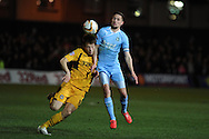 Plymouth's Conor Hourihane ® is challenged by Newport's Max Porter.  . Skybet football league two match, Newport county  v Plymouth Argyle at Rodney Parade in Newport, South Wales on Tuesday 8th April 2014.<br /> pic by Andrew Orchard, Andrew Orchard sports photography.