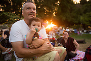 Abe Duran enjoys music with his granddaughter Daryn Adao, 1, as Big Blu Soul Revue performs during the City of Milpitas Summer Concert Series at Murphy Park in Milpitas, California, on July 26, 2016. (Stan Olszewski/SOSKIphoto)