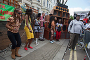 The 49th Notting Hill Carnival in West London. A celebration of West Indian / Caribbean culture and Europe's largest street party, festival and parade. Revellers come in their hundreds of thousands to have fun, dance, drink and let go in the brilliant atmosphere. People dancing to Dub Reggae at Channel One Sound System.
