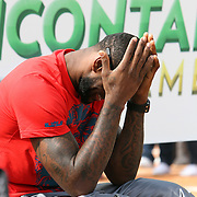 NBA All Star LeBron James bows his head in laughter at an event at the Boys & Girls Club of Central Florida on Saturday, Feb. 25, 2012 in Orlando, Florida. The LeBron James Family Foundation and Sprite donated sporting equipment and introduced a new baseball diamond, renovated play area and a picnic area.  (AP Photo/Alex Menendez)