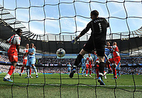 Football - Premier League - Manchester City vs. Queens Park Rangers<br /> Manchester City's Edin Dzeko rises to head in their second goal past Paddy Kenny of Queens Park Rangers at the Etihad Stadium, Manchester