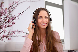 Young woman portrait call-centre pretty headset