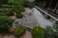 """Soanji Garden - The garden at Soanji is called """"Hikone Shiramichi-no-Niwa or Hakuro-no-Niwa.At the back of the main hall you can see the dry landscape garden, the dry pond garden, and two gardens.Each of them expresses the teachings of the Jodo sect's """"Nigabyakudo"""". Yoshinobu.The white gravel is made of Argentine stone, that is illuminated on the moonlit nights and giving it a white glow. This """"white dew garden"""" was created in the style of Kobori Enshu though its creator is not known.  The stone lantern in front of the main hall wasdesigned byMasataro Kawakatsu,a leading figure in stone statue art during the Showa era"""