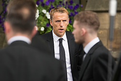 © Licensed to London News Pictures. 27/08/2015. Bury, UK.  Picture shows Phil Neville. The funeral of Neville Neville father of footballers Gary & Phil Neville & England net ball coach Tracey has taken place today at Bury Parish church. Neville died in Australia after being taken ill on a visit to support his daughter  Tracey.  Photo credit: Andrew McCaren/LNP