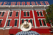 A cowboy looks up at the Wrangler western wear store  July 23, 2015 in Cheyenne, Wyoming. The store opened in 1943 is the largest western wear outfitter in America.