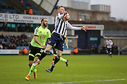 Millwall striker Aiden O'Brien (22) holding up ball from Bournemouth Defender Marc Wilson (20) during the The FA Cup 3rd round match between Millwall and Bournemouth at The Den, London, England on 7 January 2017. Photo by Matthew Redman.